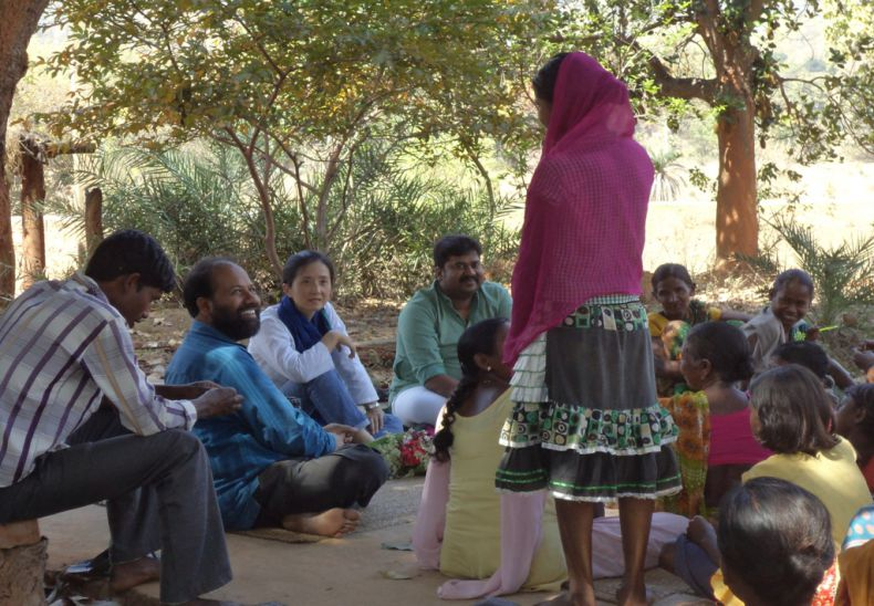 Adolescent girls and women folk discussing with UNICEF state head in Disha program village