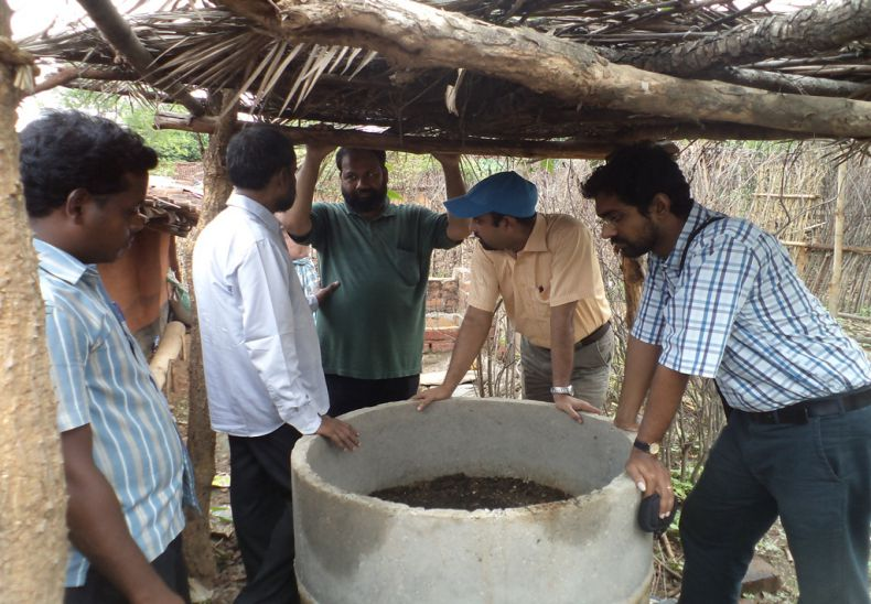 Inspecting vermin pits by Mennonite Central Committee officers